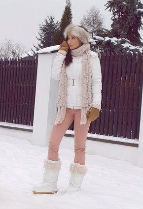 white down jacket with light gray knitted scarf and snow boots made of faux fur