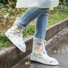 white half pure rubber snow and rain boots with jeans and tee