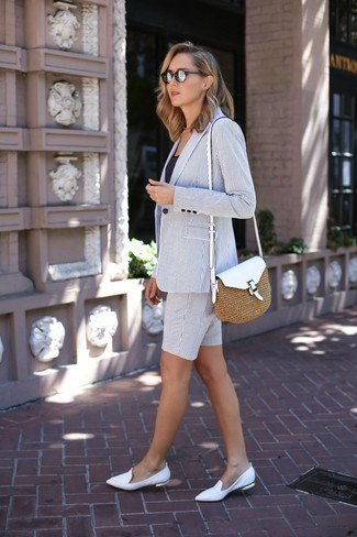 gray blazer with matching shorts and white leather shoes