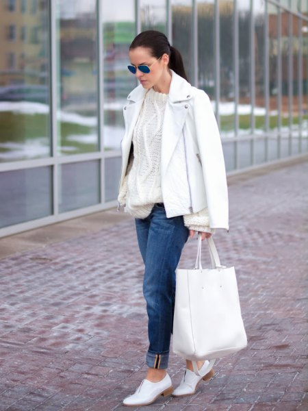 leather jacket with knitted sweater and white shoes