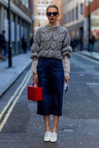gray chunky sweater with navy midi skirt and white leather shoes