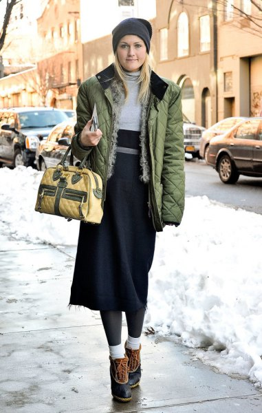 brown quilted jacket with gray and black midi shift dress and short snow boots
