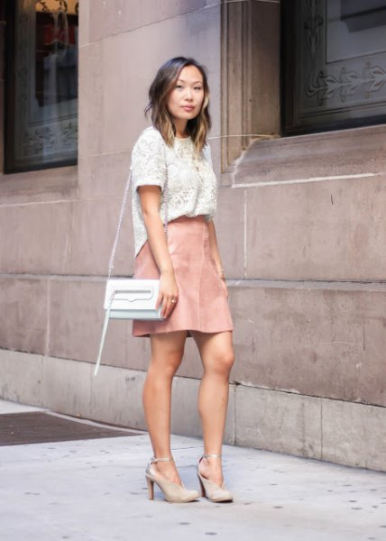 white lace short-sleeved top with light pink leather mini skirt
