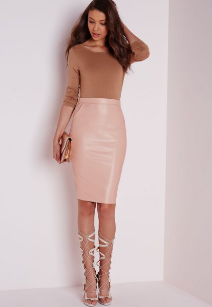 green form fitting sweater with high waist pale pink leather knee length skirt