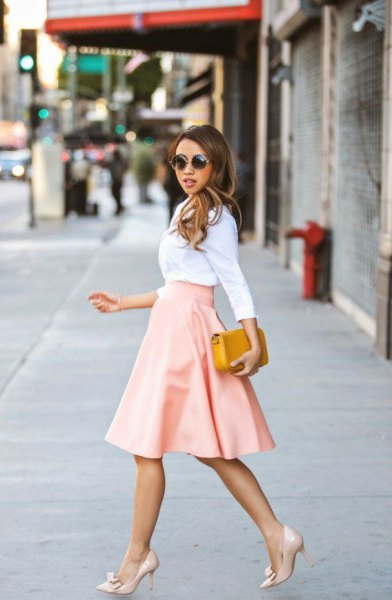 white shirt with high waist blown midi leather pink skirt