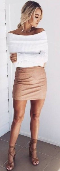 white boat neck shaped ribbed sweater with mini bodycon skirt
