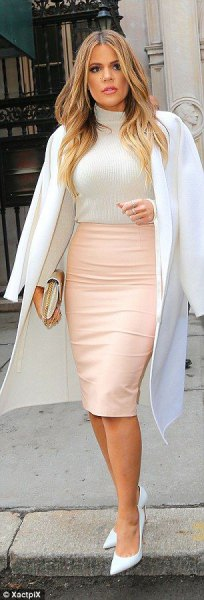 white long wool coat with rowdy midi bodycon leather skirt