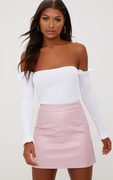 light pink skirt with white tube top and separated long sleeves