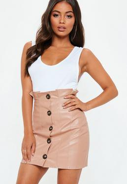 white bucket neck top with pink high waist button foreskin