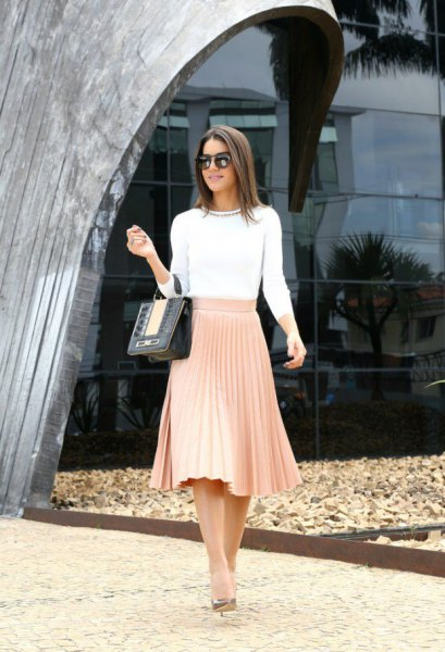 white bikini sleeveless sweater with blush midi-pleated skirt