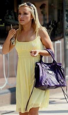 yellow chiffon babydoll mini dress with black leather bag