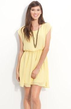 yellow sleeveless gathered waist chiffon dress