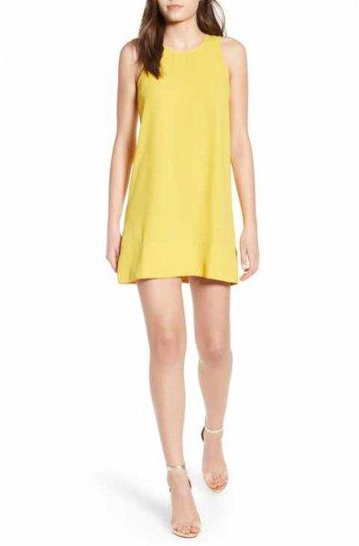 yellow mini tank top dress with silver heels