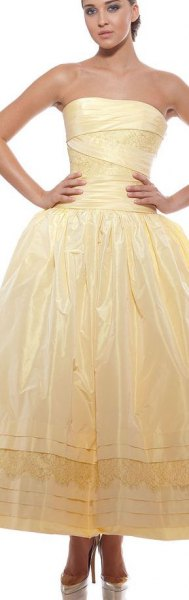 yellow strapless fit and shiny shiny maxi-prom dress