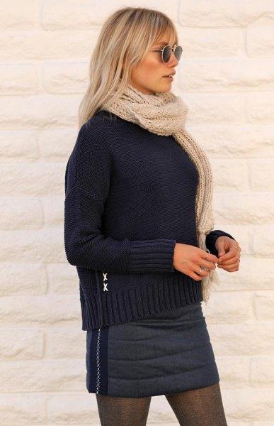 black knitted sweater with dark gray mini skirt