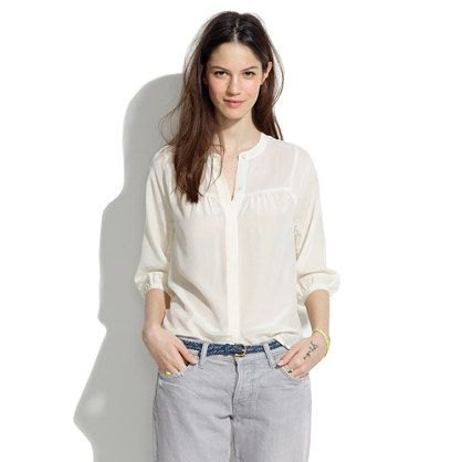 light yellow no collar shirt with light gray jeans