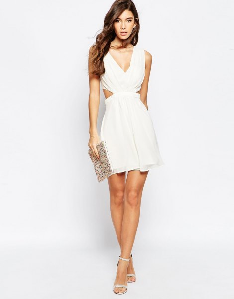 white deep v-neck cut-out side mini puffy dress with sequin bag