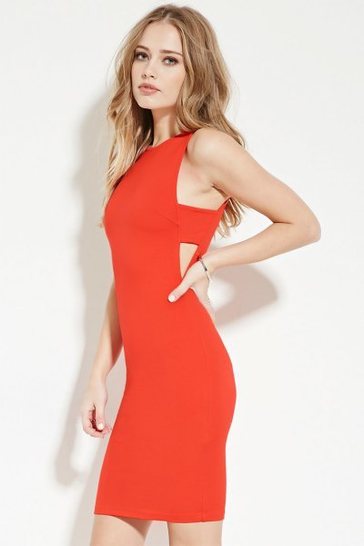 red cut-off side dress with black heels