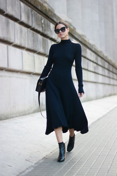 black form fitting puffy midi dress with ankle boots