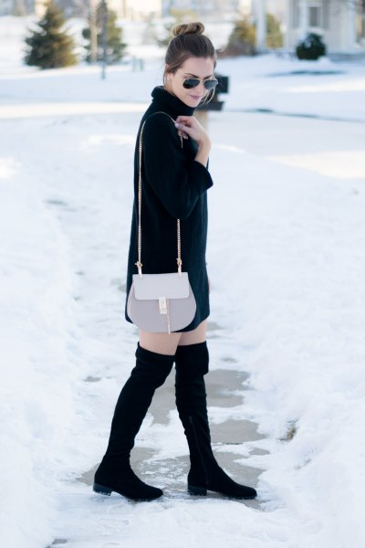 pink stylish handbags and black thigh high boots