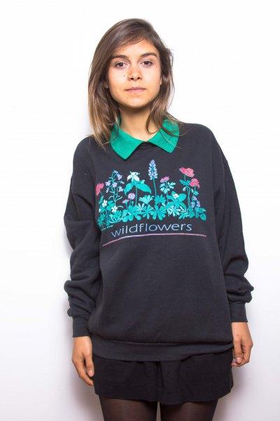 black printed sweater with mini skirt