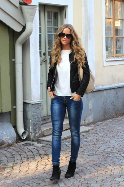 bomber jacket with slim jeans and black wedge boots