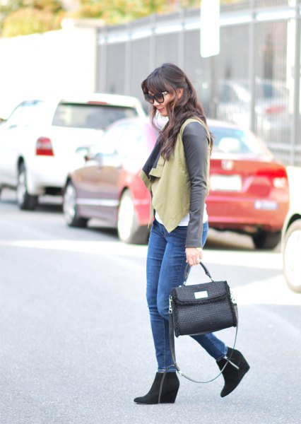 crepe vest with gray long-sleeved tee and black ankle boots
