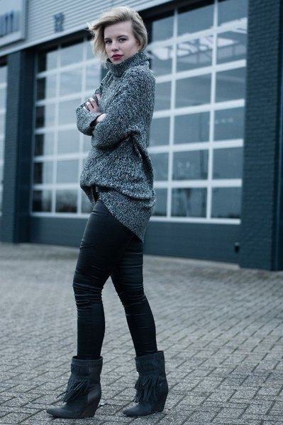 gray turtleneck chunky sweater with leather pants and black booties