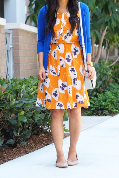 royal blue cardigan with orange knee-length swing dress