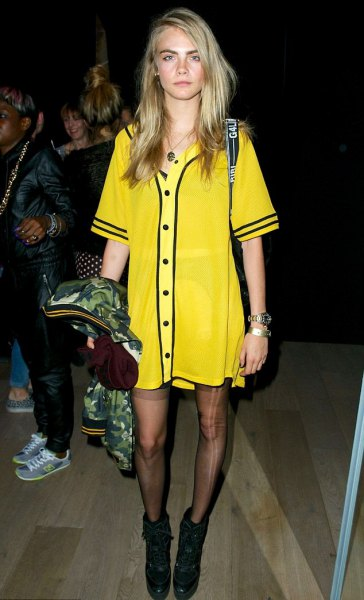 yellow and black printed t-shirt dress with socks and boots
