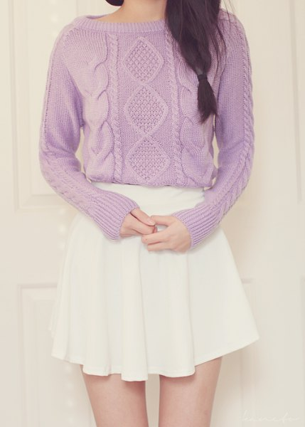 knitted sweater with boat neck cable with white mini pleated skirt