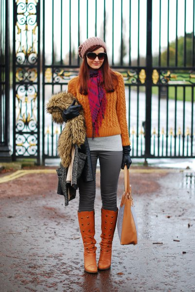 orange knitted sweater with matching knee-high boots
