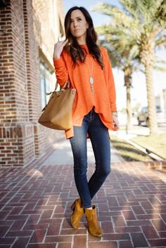 dark orange leather boots with chiffon blouse and jeans