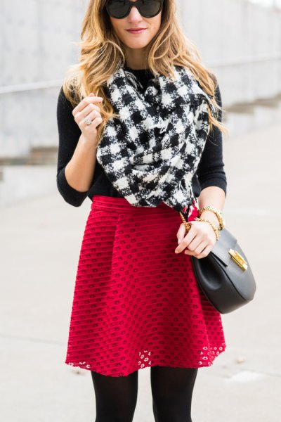 black and white checkered scarf with red semi-clean skirt