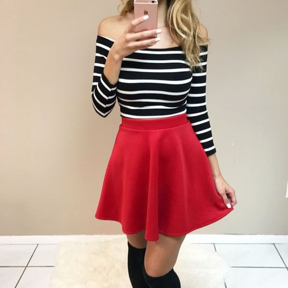 from the shoulder black and white striped top with long sleeve with red skater skirt