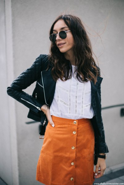 black quilted leather jacket with orange suede button front skirt