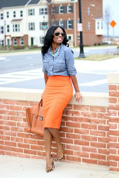 blue chambray shirt with orange midi skirt