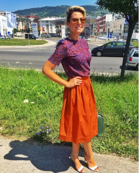 blue printed short sleeved blouse with orange midi skirt