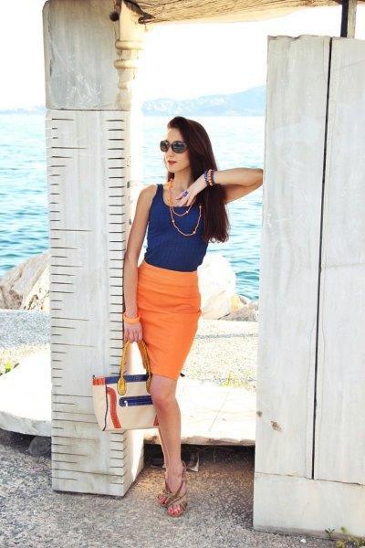 navy blue vest top with orange bodycon knee length skirt