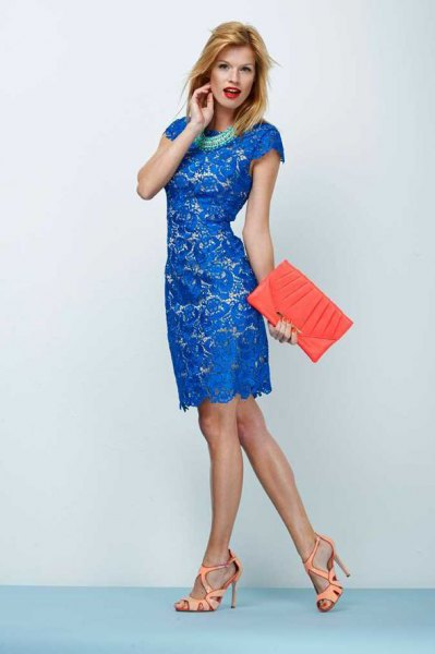 royal blue cap in knee-length lace dress