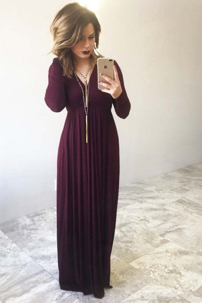 maxi dress with long sleeves and long fringed necklace