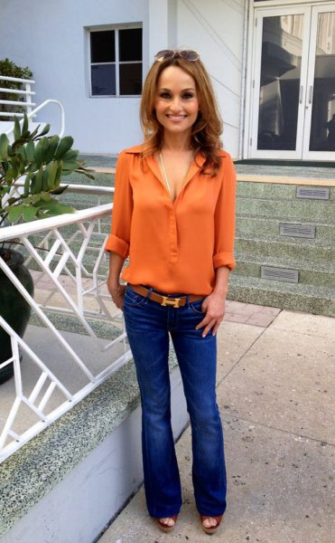 orange button up chiffon shirt with blue puffed jeans