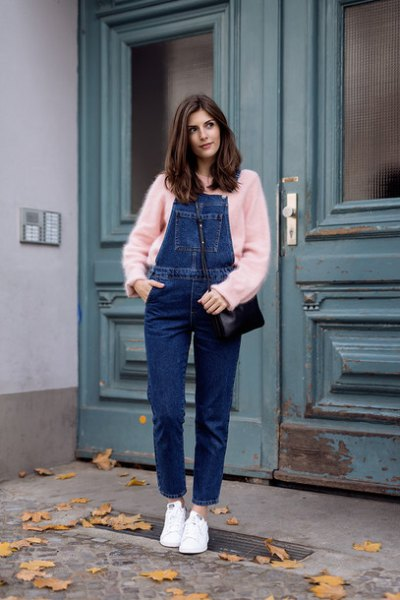 red sweater with blue denim overalls