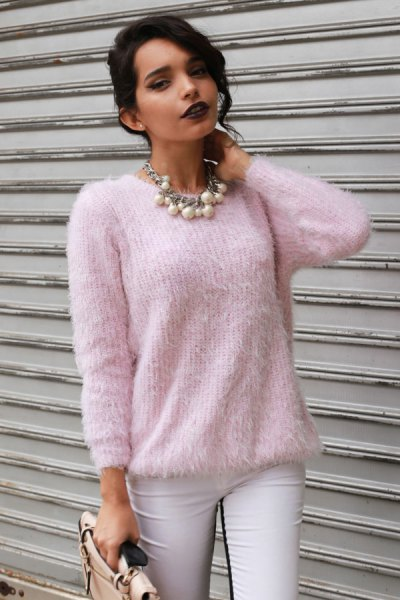 light pink fuzzy sweater with white skinny jeans