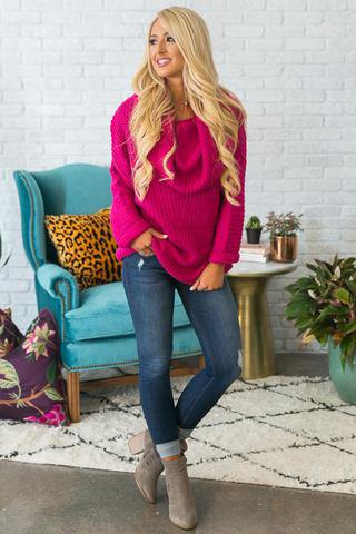 pink ribbed chunky sweater with cuffed jeans and gray boots