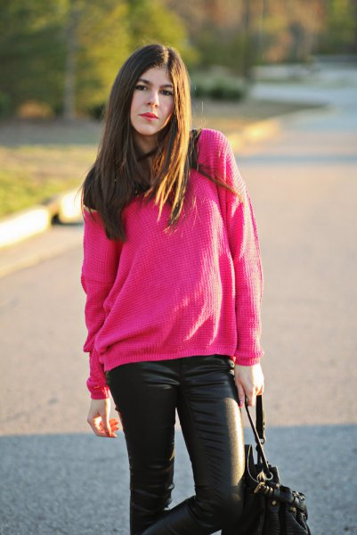 chunky pink sweater with black leather pants