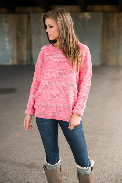 pink knitted sweater with gray suede high boots