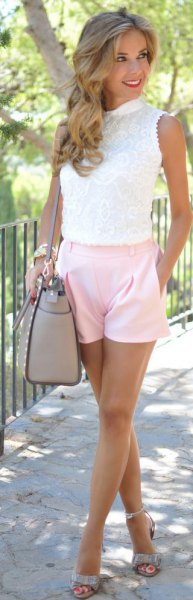 white sleeveless lace blouse with light pink shorts