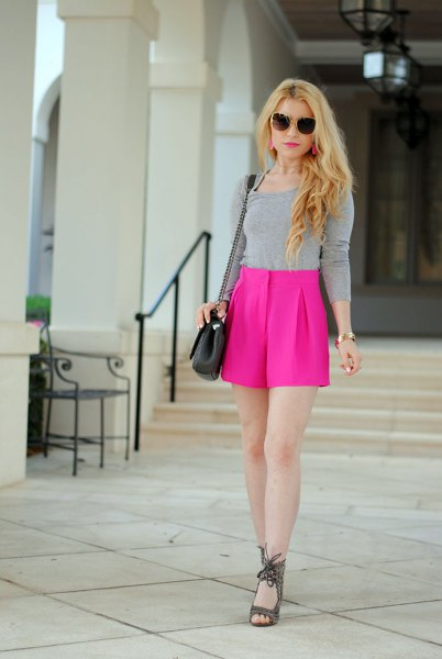 gray form fitting long sleeve tee with high waist pink flowing shorts