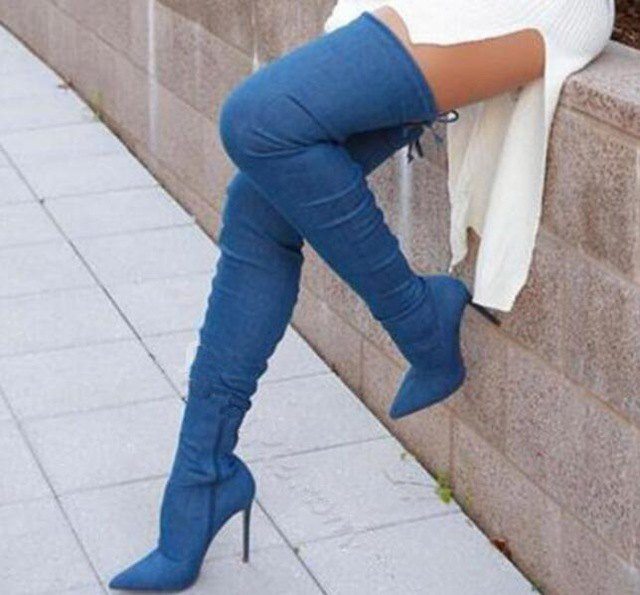 white ribbed sweater dress with high-heeled denim thigh high boots